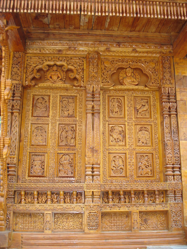 India travel pictures: beautiful carved temple door all possible gods