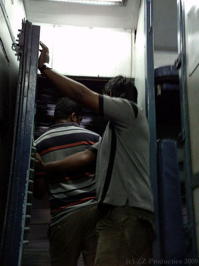Guys in train door