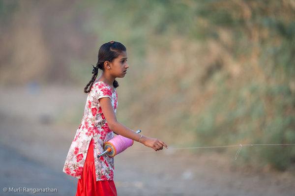 Name:  girl flying a kite-1.jpg Views: 461 Size:  39.6 KB
