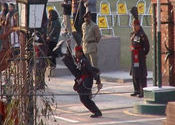 Border ceremony: Pakistani foot up by olias.  Tags: Crossing the Border, up, pakistani.