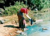 Sari washing in jungle river by Susiewoo.  Tags: kapci, sari, washing, river.