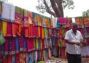Sari Seller by theyyamdancer.  Tags: Odisha, Odisha, sari.