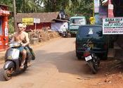 Chapora Tourists In A Hurry by Lou Wilson.  Tags: Goa, Vagator Beach, People and Faces, bike, chapora.