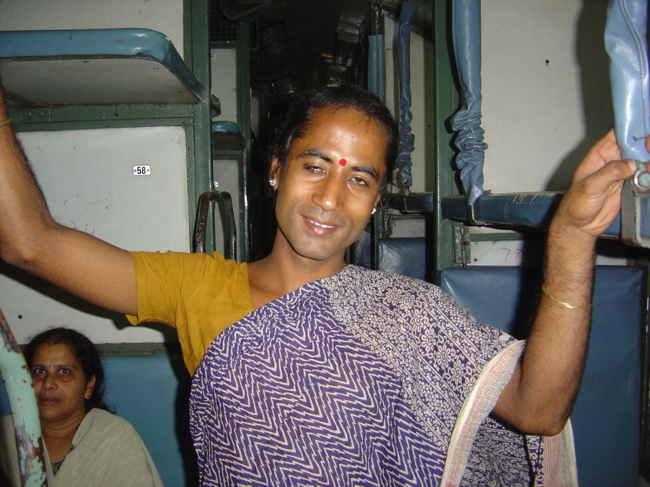 http://www.indiamike.com/files/images/16/99/11/hijra-on-the-train.jpg