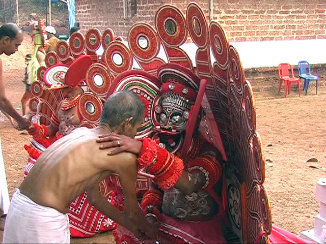 Receiving a blessing by Sasthappan, a mistreated boy who went rampage and was turned to a deity
