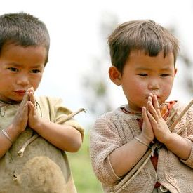 Namaste! Two young children welcome us in Sikkim